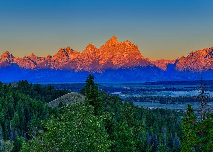 Tetons Greeting Card featuring the photograph Alpenglow Across The Valley by Greg Norrell