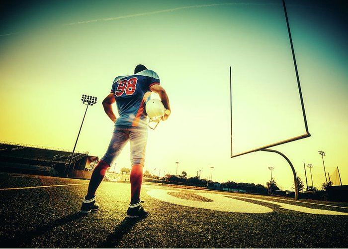 Headwear Greeting Card featuring the photograph American Football Player by Ferrantraite