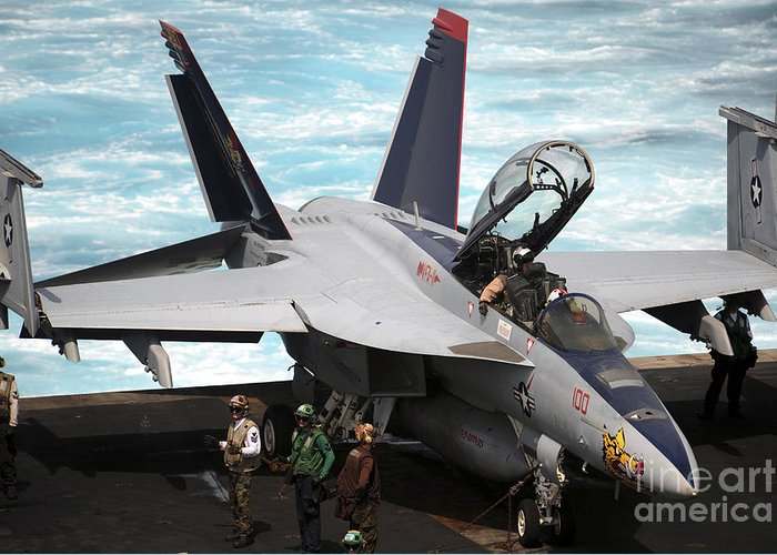 Military Greeting Card featuring the photograph An Fa-18f Super Hornet Sits by Stocktrek Images