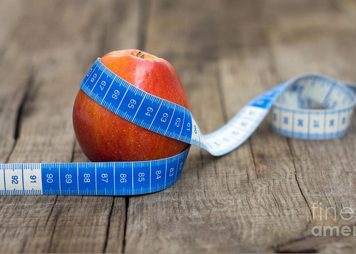 Apple Greeting Card featuring the photograph Apple And Measuring Tape by Aged Pixel
