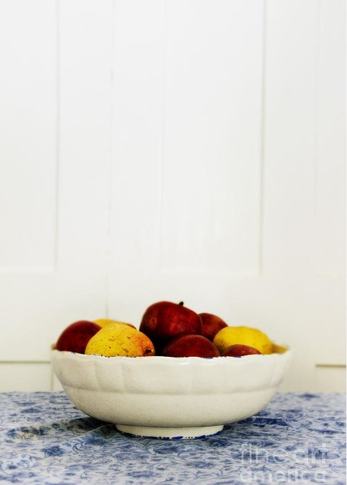 Fruit; Bowl; Still Life; Table; Table Cloth; Bowl Of Fruit; Fresh; Food; Kitchen; Old; Apples; Red; Yellow; Inside; Indoors; White; Blue; Minimal; Minimalism; Wall; Wood Greeting Card featuring the photograph Apples by Margie Hurwich