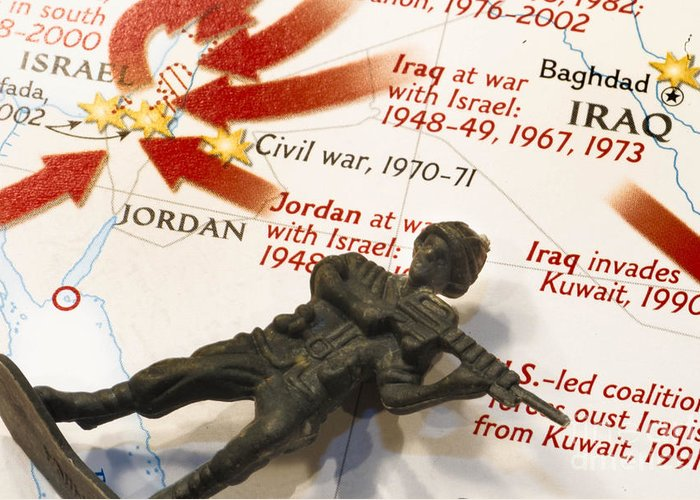 Aggression Greeting Card featuring the photograph Army Man Lying On Middle East Conflicts Map by Amy Cicconi