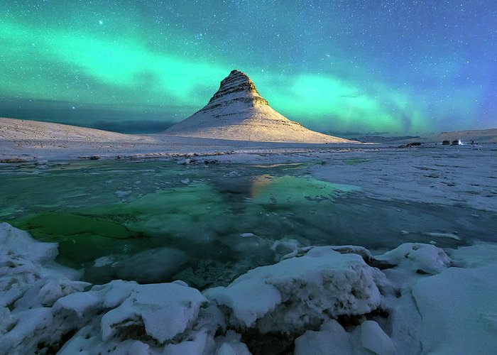 Tranquility Greeting Card featuring the photograph Aurora Over Kirkjufell Mountain Iceland by Ratnakorn Piyasirisorost