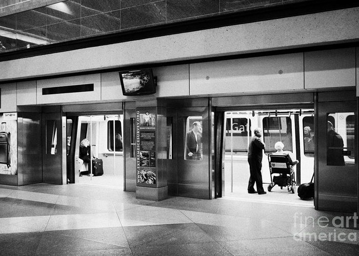 Automated Greeting Card featuring the photograph automated guideway transit system at Denver International Airport Colorado USA by Joe Fox