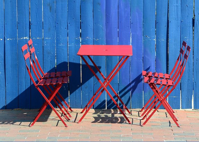 Red Blue Chair Table Fence Pick Nick Outdoor Annapolis Hungry Ice Cream Greeting Card featuring the photograph Awaiting by