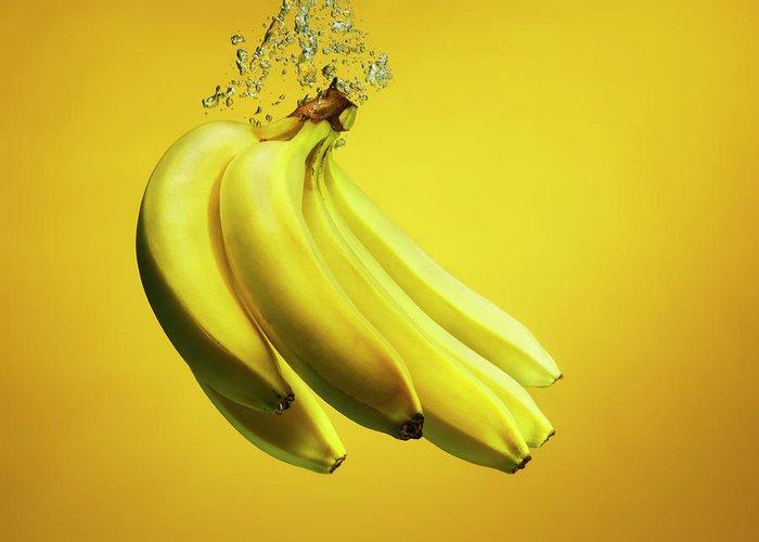 Copenhagen Greeting Card featuring the photograph Bananas Splashed Into Water by Henrik Sorensen