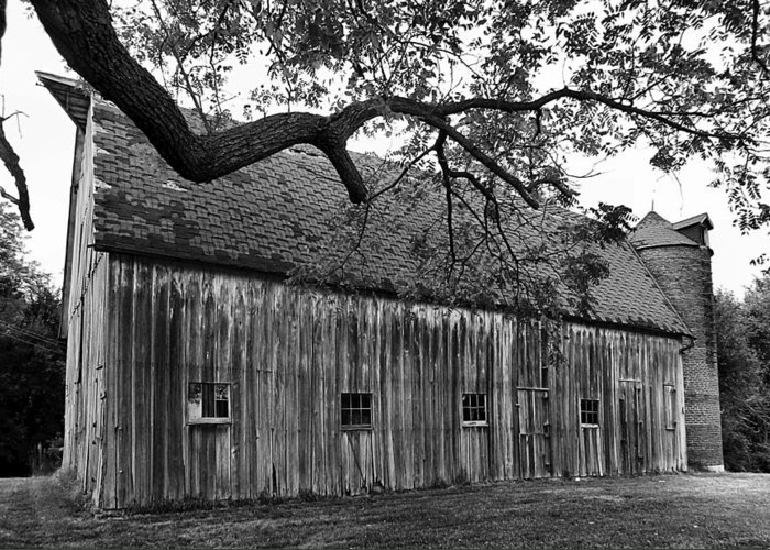 Old Barns Greeting Card featuring the photograph Barn With Brick Silo In Black And White by Julie Dant