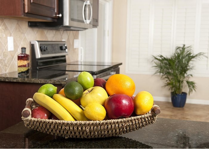 Kitchen Greeting Card featuring the photograph Basket Of Fresh Fruit In Modern Kitchen by Joe Belanger