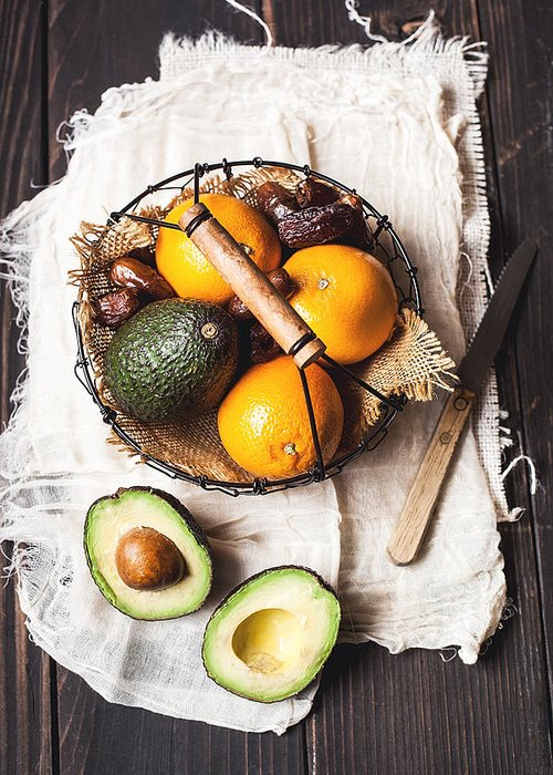 San Francisco Greeting Card featuring the photograph Basket With Avocado, Oranges And Dates by One Girl In The Kitchen