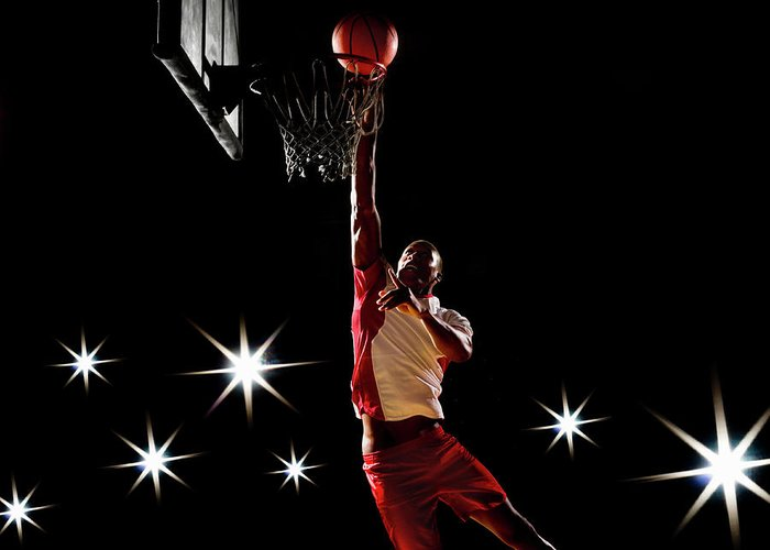 Three Quarter Length Greeting Card featuring the photograph Basketball Player Dunking Basketball On by Compassionate Eye Foundation/chris Newton