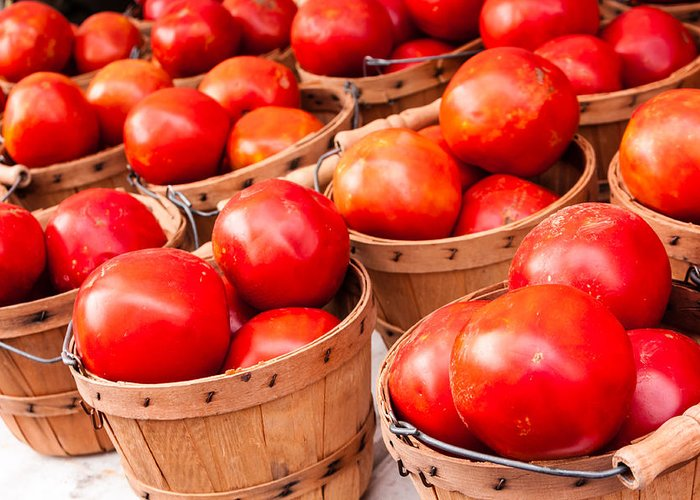 Agriculture Greeting Card featuring the photograph Baskets Of Tomatoes At A Farmers Market by Teri Virbickis
