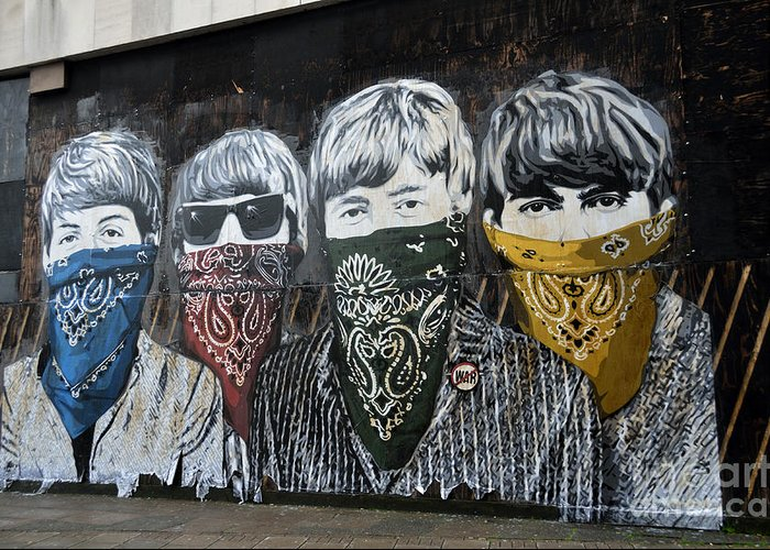 Banksy Greeting Card featuring the photograph The Beatles wearing face masks street mural by RicardMN Photography
