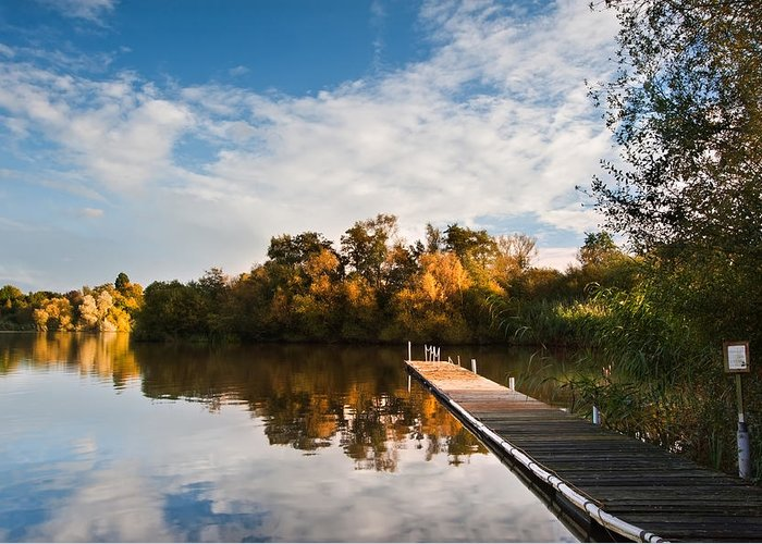 Landscape Greeting Card featuring the photograph Beautiful Sunset Over Autumn Fall Lake With Crystal Clear Reflec by Matthew Gibson