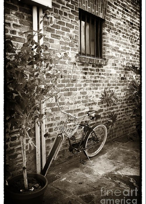Bike In Pirates Alley Greeting Card featuring the photograph Bike In Pirates Alley by John Rizzuto