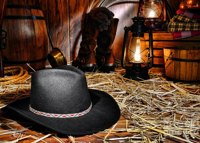 Western Greeting Card featuring the photograph Black Cowboy Hat In An Old Barn by Olivier Le Queinec