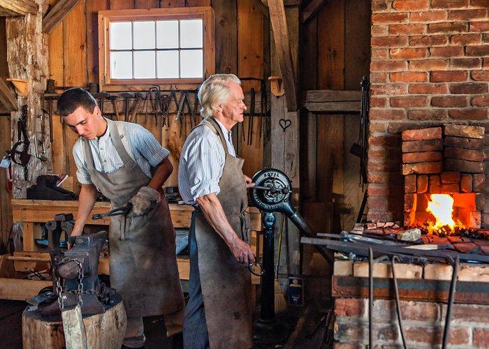 Blacksmith Greeting Card featuring the photograph Blacksmith And Apprentice 2 by Steve Harrington