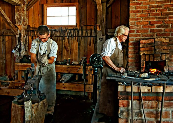 Blacksmith Greeting Card featuring the photograph Blacksmith And Apprentice by Steve Harrington