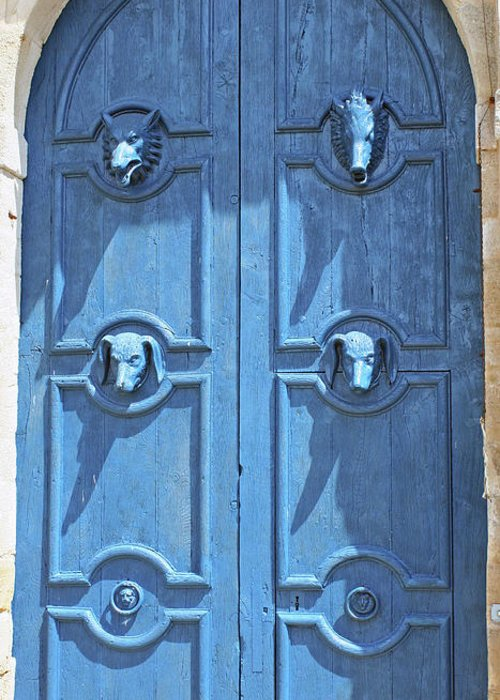 Blue Door Greeting Card featuring the photograph Blue Door Decorated With Wooden Animal Heads by Christiane Schulze Art And Photography