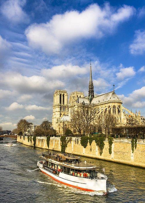 Paris Greeting Card featuring the photograph Boat Passing Notre Dame De Paris by Mark E Tisdale