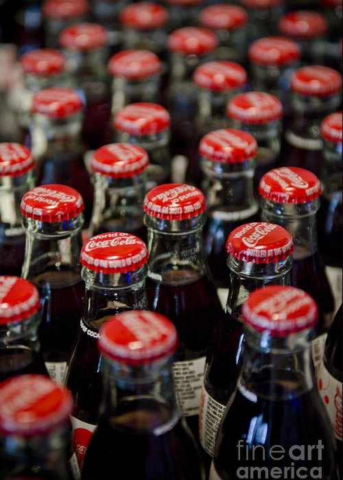 Coke Greeting Card featuring the photograph Bottle Caps by Jessica Berlin