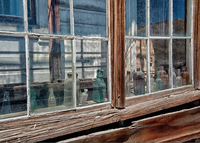 Glass Greeting Card featuring the photograph Bottles In The Window by Cat Connor