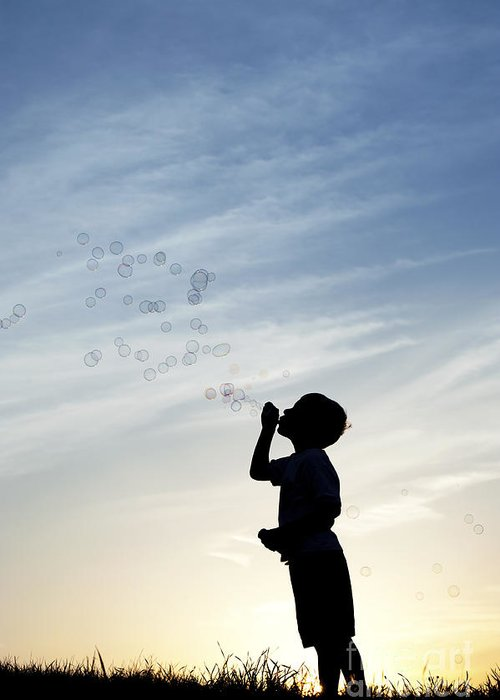 Boy Greeting Card featuring the photograph Boy Blowing Bubbles by Tim Gainey