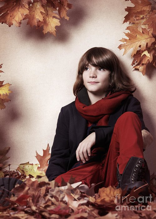 Boy Greeting Card featuring the photograph Boy Sitting On Autumn Leaves Artistic Portrait by Oleksiy Maksymenko