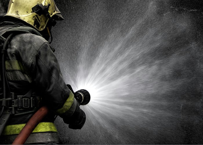 Fireman Greeting Card featuring the photograph Brave Man by Jorge Feteira