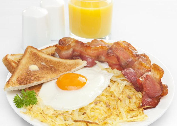 American Breakfast Greeting Card featuring the photograph Breakfast Hash Browns Bacon Fried Egg Toast Orange Juice by Colin and Linda McKie