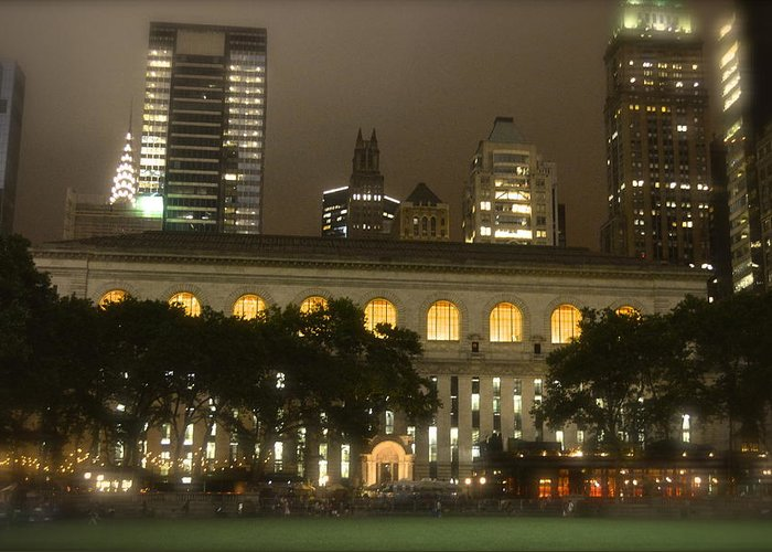 Bryant Park In New York City At Night Greeting Card featuring the photograph Bryant Park In New York City At Night by Michael Dagostino
