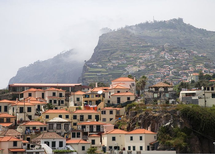 Horizontal Mist Misty Cable Car Outdoor Tourist Tours View Spectacular Vacation Holiday Atlantic Ocean Portuguese Sea Cliff Steep Escarpment Look Out Point Panoramic Coast Coastline Waves Exterior Landscape Mountains Rocks Mountainous Calm Water Summer Seashore Color Color Daytime Outdoor Nobody Houses Red Roofs Village Hillside Slope Greeting Card featuring the photograph Cabo Girao Madeira Portugal by Jim Wallace