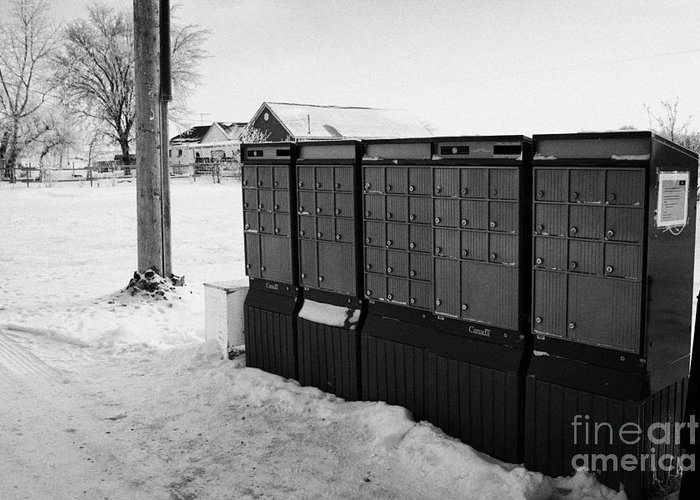Canada Greeting Card featuring the photograph canada post post mailboxes in rural small town Forget Saskatchewan Canada by Joe Fox