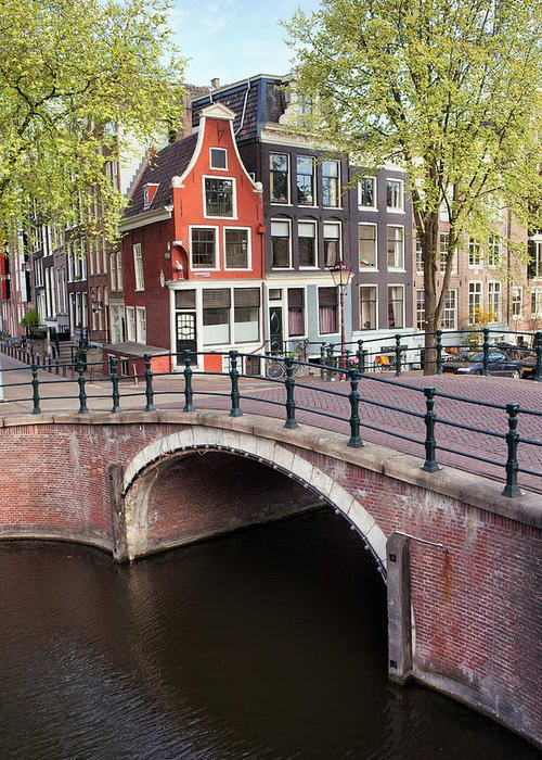 Amsterdam Greeting Card featuring the photograph Canal Bridge And Houses In Amsterdam by Artur Bogacki