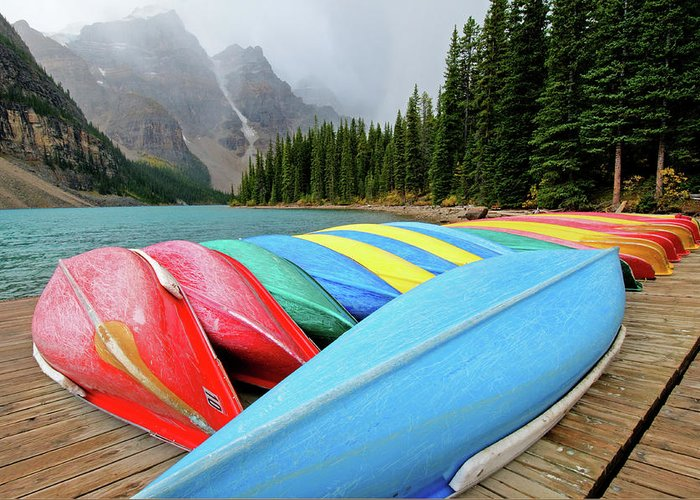 Scenics Greeting Card featuring the photograph Canoes Line Dock At Moraine Lake, Banff by Wildroze