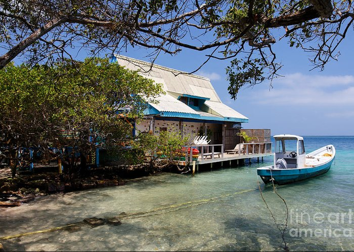 Adrift Greeting Card featuring the photograph Caribbean House And Boat by Jannis Werner