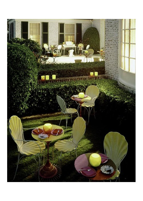 Furniture Greeting Card featuring the photograph Chairs And Tables In A Garden by Ernst Beadle