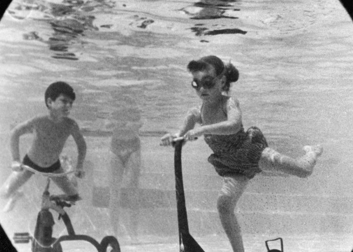 1958 Greeting Card featuring the photograph Children Playing Under Water by Underwood Archives