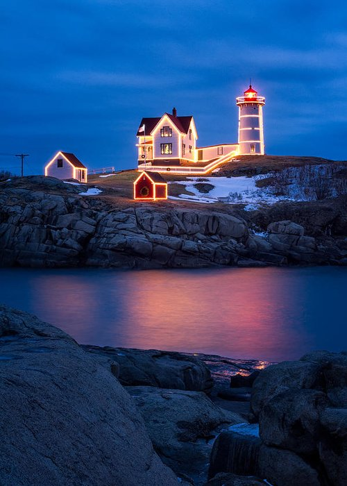 Christmas Greeting Card featuring the photograph Christmas Time At Nubble Light. by Jeff Sinon