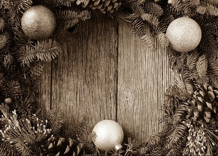 Advent Greeting Card featuring the photograph Christmas Wreath With Ornaments And Pine Cones On Rustic Wood Ba by Brandon Bourdages