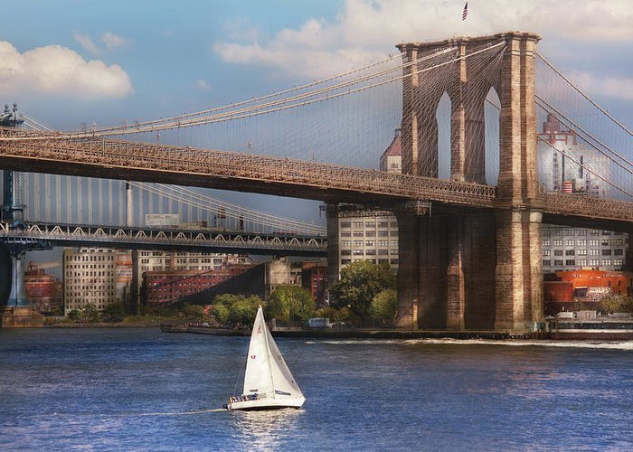 Savad Greeting Card featuring the photograph City - Ny - Sailing Under The Brooklyn Bridge by Mike Savad