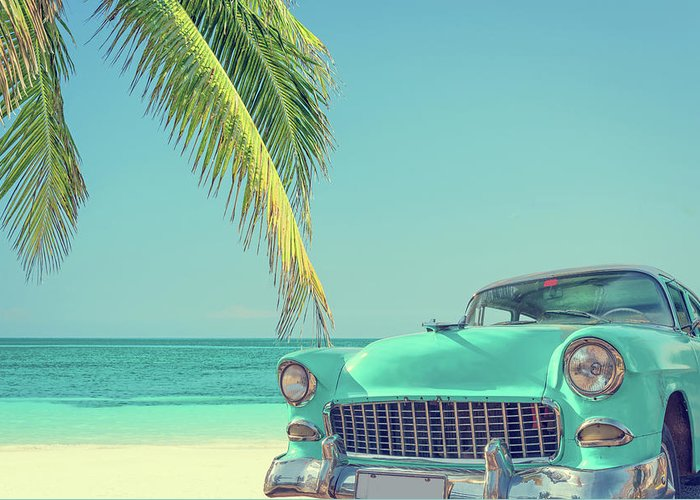 Scenics Greeting Card featuring the photograph Classic Car On A Tropical Beach With by Delpixart