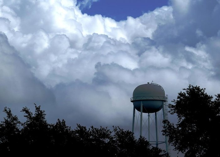 Clouds Greeting Card featuring the photograph Clouds Around The Water Tower by Zina Stromberg