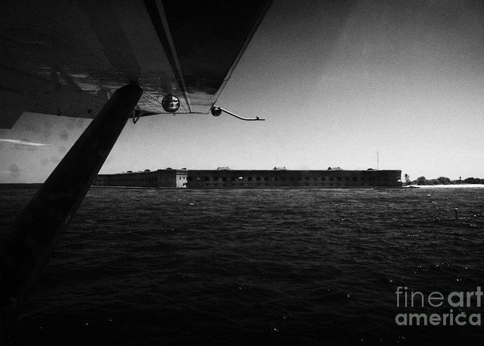 Coming Greeting Card featuring the photograph Coming In To Land On The Water In A Seaplane Next To Fort Jefferson Garden Key Dry Tortugas Florida by Joe Fox