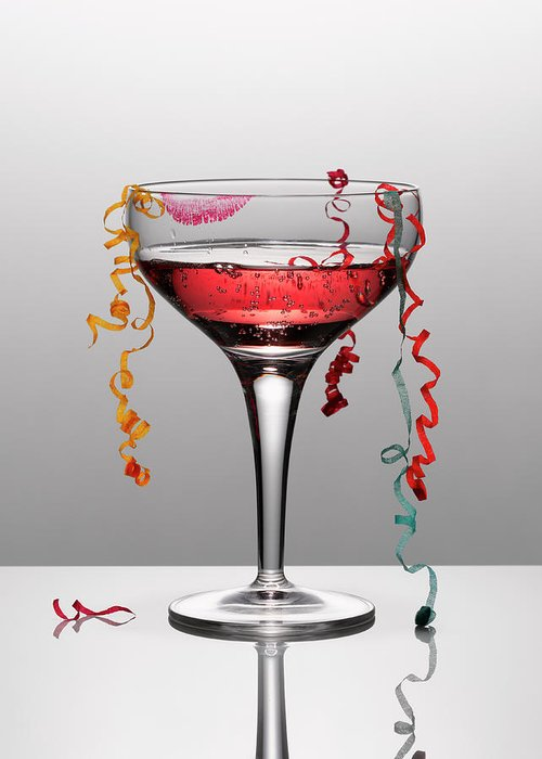 Streamer Greeting Card featuring the photograph Confetti Hanging From Glass Of Pink by Andy Roberts
