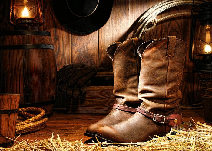 Western Greeting Card featuring the photograph Cowboy Boots In A Ranch Barn by Olivier Le Queinec