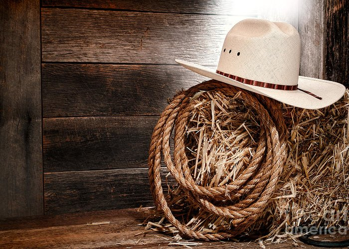 Western Greeting Card featuring the photograph Cowboy Hat On Hay Bale by Olivier Le Queinec