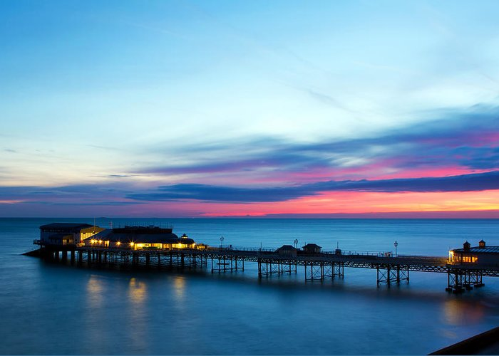 Amusements Greeting Card featuring the photograph Cromer Pier At Sunrise On English Coast by Fizzy Image