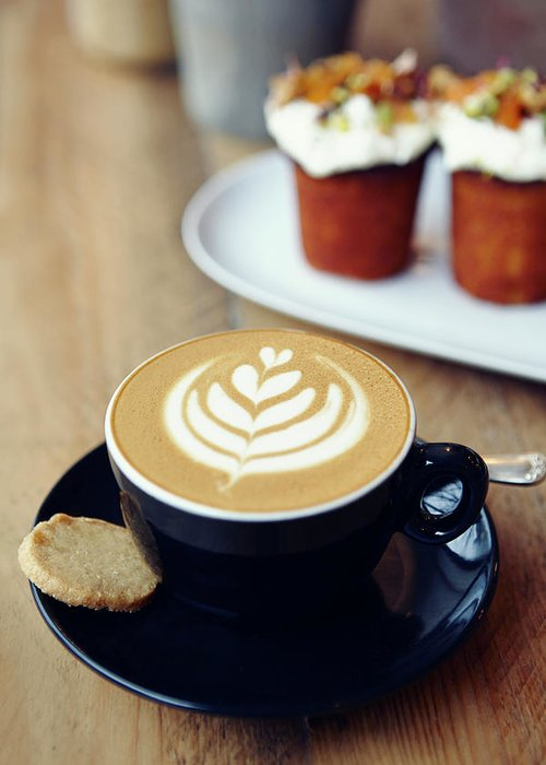 Bakery Greeting Card featuring the photograph Cup Of Coffee With Leaf Pattern On by Jake Curtis