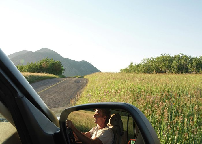 Open Greeting Card featuring the photograph Detail Of Man In Side Mirror Of Car by Philip & Karen Smith / TFA
