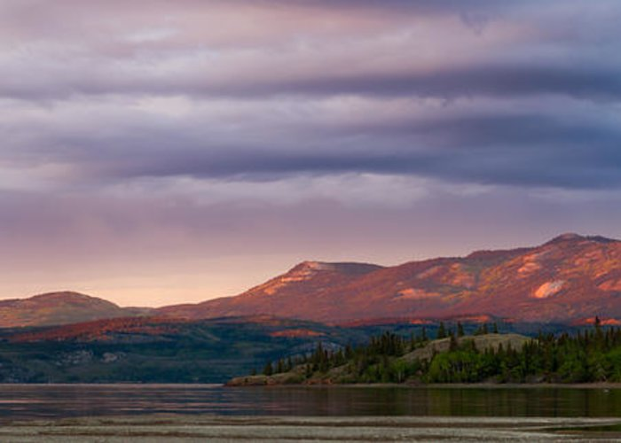 Above Greeting Card featuring the photograph Distant Yukon Mountains Glowing In Sunset Light by Stephan Pietzko
